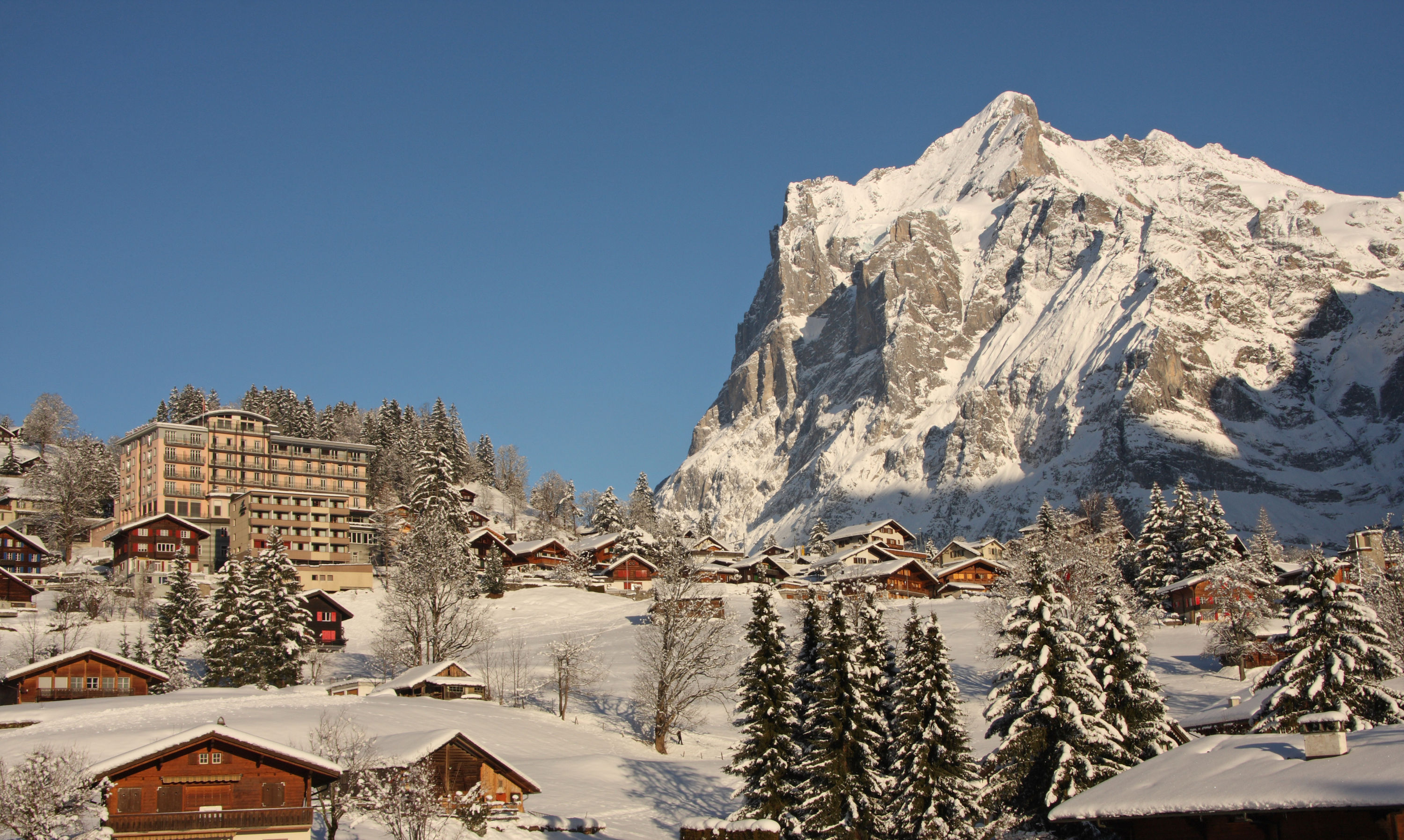 Hotel Belvedere Grindelwald in winter with the mountain Wetterhorn