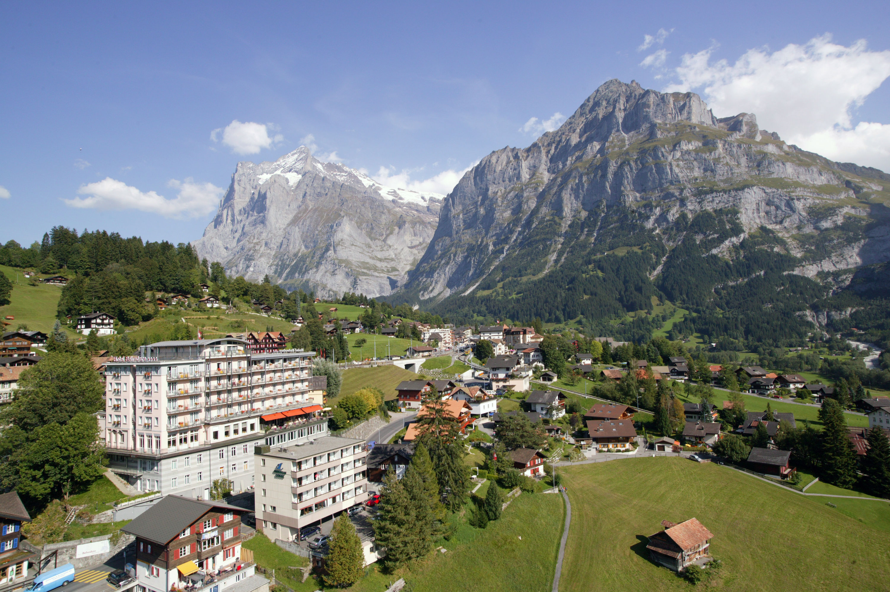 Hotel Belvedere Grindelwald in summer · mountains Wetterhorn and Mettenberg
